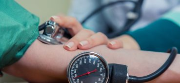 Photo of someone taking a patient's blood pressure.