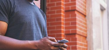 Photo of man using phone.
