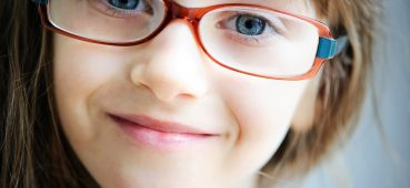 Photo of girl wearing glasses.