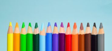 Photo of coloured pencils in a row linked to an article on running OSCE Exams.