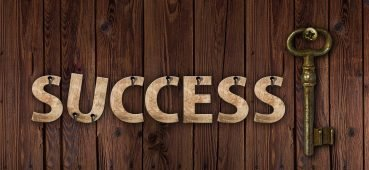 Image of the word success with a key linked to an article on student exam feedback