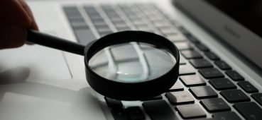 Magnify glass on keyboard to symbolise online proctoring